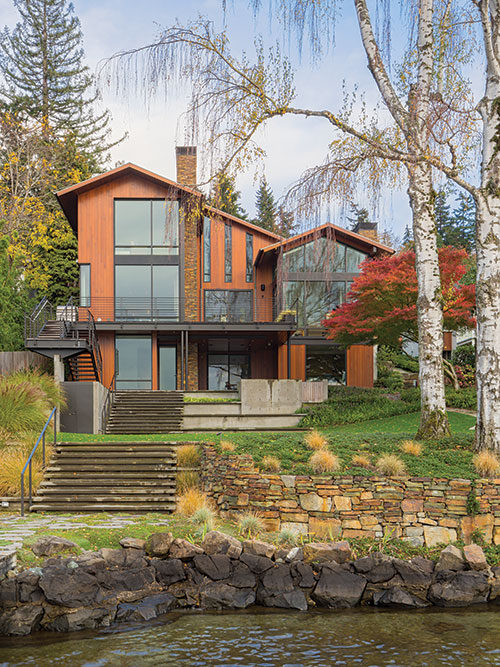 The Japanese Maple tree visible through the living room window of this Mercer Island home (alternate view below), was a gift to the owner when his father passed away. More than 20 years later it is a vibrant part of the landscape