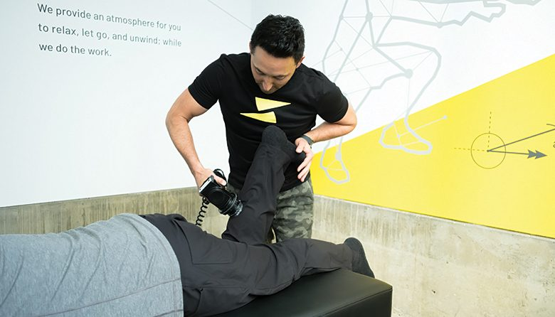 VibraCussor's stretch practitioner working on a patient
