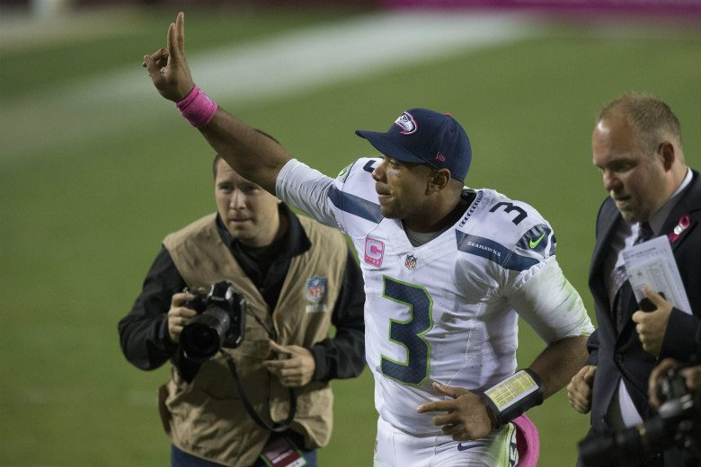 the best attitude 3c85d f0c35 Alaska Airlines Gives Seahawks Fans Wearing Russell Wilson ...