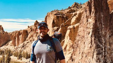 Michael Bennett stands before rock formations at Smith Rock State Park