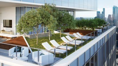 It resembles an earth-bound backyard with trees and grass but this deck at Nexus is sky high.
