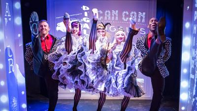 The talented ensemble cast of Can Can's 'French Kiss' perform their namesake cabaret move